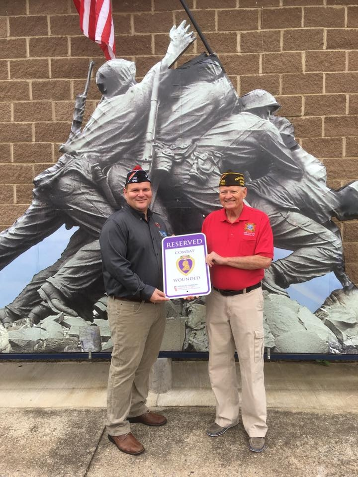 Commander Walker (16-18) Presented a Purple Heart Parking sign to Wayne Simpson Commander Post 7175.